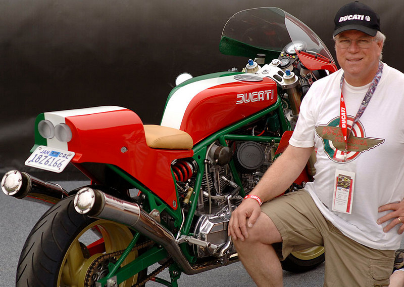 Kevin Bracken entered this crowd favorite and completely one off example. I'll let hom tell you about it:<br /> Ducati Tricolore 905 - This is what Ducati might have raced if they had continued with the bevel-drive engine in the mid-80's. The frame is a close copy of the 750F1, modified (C&J/Mark Henry) to fit the bevel engine. Suspension consists of Yamaha R1 forks and custom made Wilbers shock. Front fender is aftermarket R1. Kosman triple clamps conceal an internal fork stop. Marvic magnesium wheels, originally for the 851, are modified to fit later model axles and spacing. Tank (M. Henry) is modeled after the F1. Italian flag paint, seat and rear hugger are all by the incredible Len Lochmiller. Brakes are Brembo. The 905cc engine has '82 cases, plain bearing crank with my own design crankpin, Carrillo rods, S2 cylinders, external supply and return oil lines with full flow cooler and filter. Heads are heavily modified '84 Pantah with bevel-drive grafted on. They have re-angled, larger valves, welded and re-contoured ports (the legendary CR Axtell and me) and specially made cams (VeeTwo). JE Pistons are my own design. Dry clutch (VeeTwo) is essential because of the massive torque. Ignition (V. Sachse) is optically triggered with nine advance curves. Fuel delivery is by FCR flat slide carburetors and exhaust uses Axtell megaphones with Supertrapp cans. An earlier version of this bike placed at a Laguna BOTT in 1985. The bike is absolutely amazing to ride!!