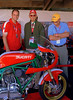 "That's Rich Lambrechts, Phil Schilling and Brian Slark looking at Kevin's bike.  This is a trio that knows what they are looking at. Brian displays the age old stance of ""motorcycle guy looking at cool bike"""