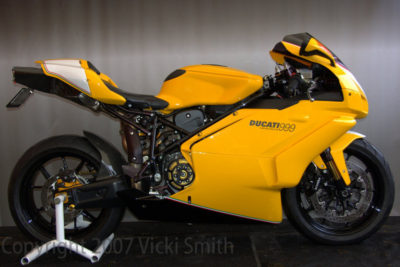John Avelluto's 2005 999 Ducati Day Daytona Concorso winner was the best example of attention to detail possibly in the whole bunch. The more you looked the more you found to admire. Here's what the bike description card said:<br /> 1 of 31 yellow 2005 999's imported in 05. This one was treated to what should have been done from the factory. All of the components that were once silver or gray are now blacked out, by methods that are factory correct. Also there are painted number boards and tri-color stripes that represent the colors of the Italian flag, birth place of this beautiful machine.Every square mm of this motorcycle has been gone over.Most of the work was carried out  by yours truly am not a m/c shop owner or a high performance parts vendor/dealer, just a pizza man with a great passion for Ducati! and I feel like this one shows. This machine is ridden daily and has almost 12,000 miles on it.This beautiful machine won in the superbike category at Ducati day Daytona 07