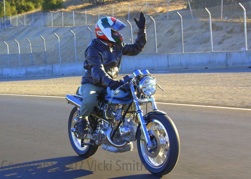 At the end of the day we headed back out on the track for a photo shoot in the corkscrew. That's Mike Cecchini waxing poetic about the racetrack. He missed the morning session so this was his first lap on the track.