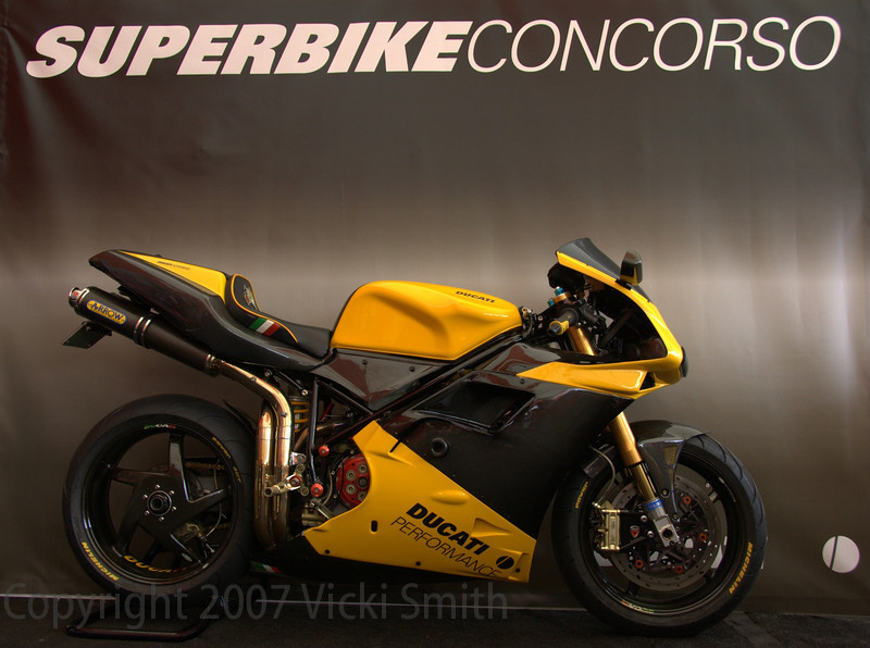 From the bike display card:<br /> 2001-996, 2005 Concours D' Elegance/Ducati Island-Best in Show/Best Superbike. Featured in Fall 2005 edition of Moto-Euro magazine.Owner Rick Henry. This bike that I have built has 26,622 miles and I ride it as much as possible! It has taken approximately 5 years and an excess of $45,000 to build. Engine:Panli-Titanium rods, high comp pistons,SPS cams, Nichols light weight flywheel, STM-crankcase breather, FIM-comp chip, Arrow-54mm full race exhaust,JHP-in box air filter,SFS-silicone hoses. DRIVE TRAIN: BST-C/F Wheels, Braketech-axis,front full floater rotors and rear, Brembo-race calipers, Brembo-race radial clutch and brake and master cylinders, Ducs-Billet drive hub, STM-quick change rear sprocket, SUR-Flex race slipper clutch.Frame: Glossyblack frame and sub-frame, Ohlins front forks, rear shocks and steering damper, Cycle Cat-top clamp, rear sets,kick stand,frame sliders, bar sliders, radial caliber brackets,SBK-ride height rod. BODYWORK: All carbon fiber,intake,headlight bucket,3-pc air box, mirrors, belly pan and rear custom Sargeant seat. Ducati is not only a work of art but a lifestyle!