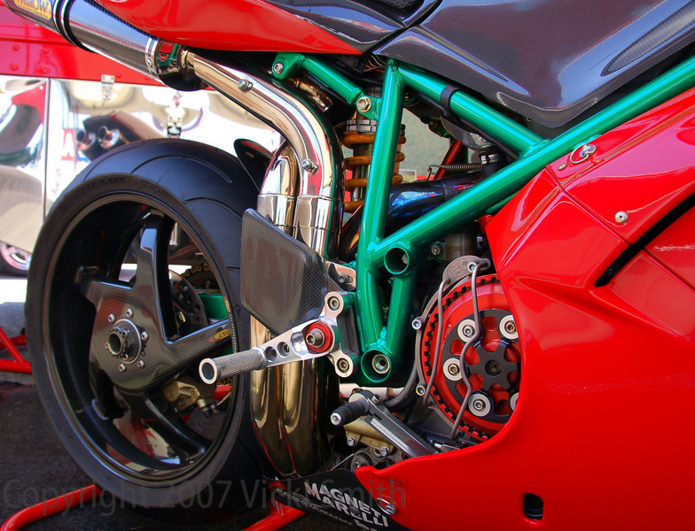 "From the display card:  Moto Euro ""Best Superbike"" 2006 Moto GP event at Laguna Seca.  Mike Lancaster Re-Build completed 2005 includes: BST Carbon Fiber Wheels, Michelin Pilots, QB Carbon Endurance headlight fairing/belly pan, Brake-Tech Full Floating Rotors,DP air box/intakes, Ohlins R&T forks/Rear Shock/Steering Stabilizer, DID ERV 520 chain, STM Slipper Clutch,SPS Cams, Nichols Light Weight Flywheel, High Compression Head Gasket, STM Crank Case Breather,Polished 54mm Arrow Race Exhaust, STM Quick Change Carrier and Rear Sprocket, Light-weight Counter Shaft Sprocket, Woodcraft 53mm Clip-ons w/ Carbon Fiber Handlebars Carrier, Carbon Fiber Rear Hugger, WSB Red Anodized Ride Height Rod Integrated LED Front and Rear Turn Signals, Anodized Battery Box, Drive Hub, License Plate Mount Cycle Cat Top Clamp, Rear Sets, Bar and Frame Sliders, STM Titanium Toe Guard, European Cycle Specialties in-box Air Filter,Custom Sergeant Seat"