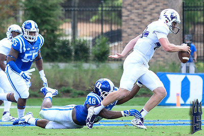 Deion Williams goes for the tackle / Duke Blue Devils / Photo by Chris Summerville