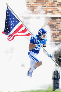 Kyler Brown carrying the colors / Duke Blue Devils / Photo by Chris Summerville