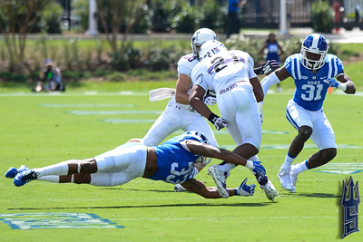 Deondre Singleton with the tackle / Duke Blue Devils / Photo by Chris Summerville