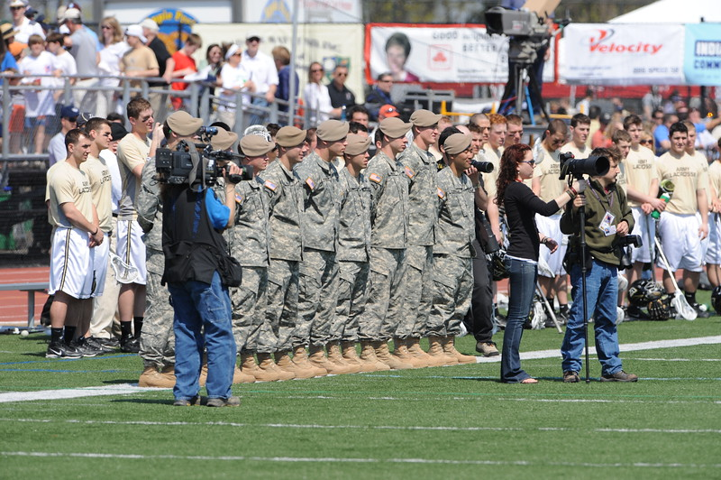 Casey Carroll, Duke All American Defenseman and 2007 Graduate, is second from the right in the group of Soldiers.