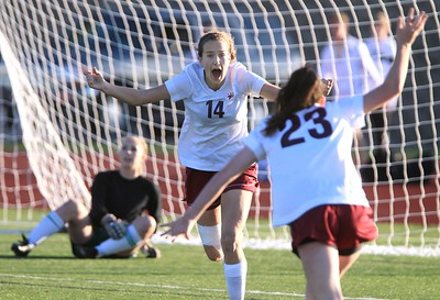 Torrey Pines' Katherine Trees, left, and Courtney Massimino celebrate Torrey Pines' game winning goal in overtime as Poway's goalie Kara Stickney sits in the background during the CIF Girls Division I soccer championship at Westview High School on Saturday. Photo Hayne Palmour IV