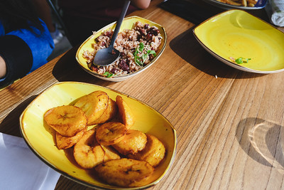 Fried sweet plantains and rice & peas