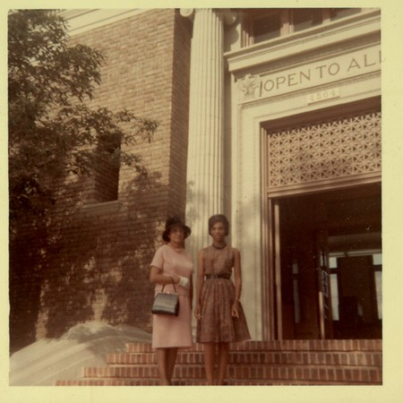 Two women standing on the stairs of the Vernon Library