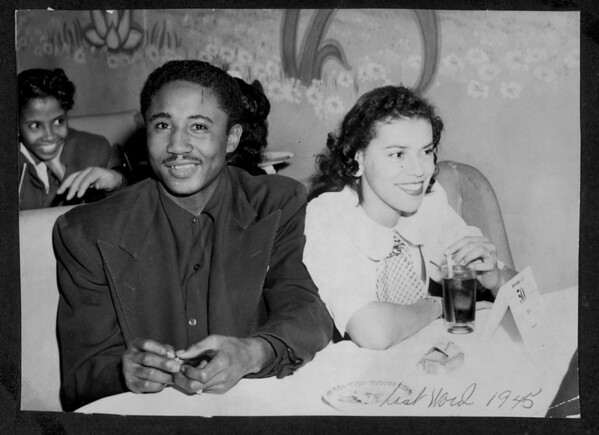 A couple sitting together in a booth at the Last Word Club
