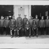 A portrait of the men of Engine Company No 30 standing side by side in line