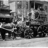 Firemen of Engine Company No. 30 riding a horse and buggy in the La Fiesta parade
