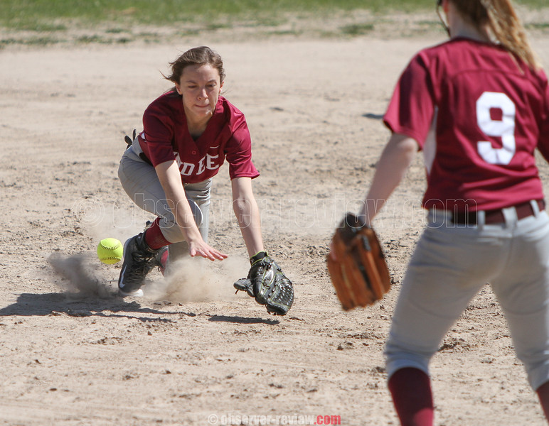 Action during the Dundee and Romulus softball game, May 2, 2015.