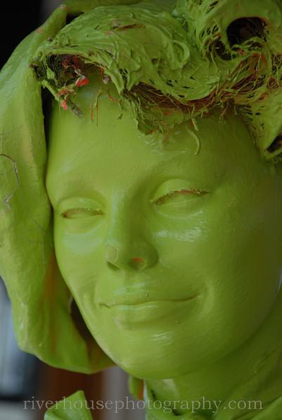 Mannequin in creepy green enamel.