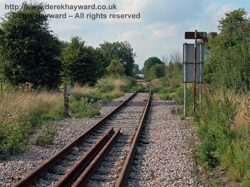 In this view north, taken from Brookland level crossing on 02.09.2005, the old station building is concealed by the back of the sign on the right, but the picture relects the rather neglected state of the area in 2005.