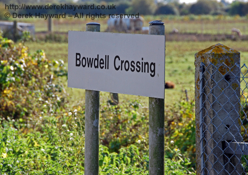 Bowdell Crossing has a nice modern sign, but they could have painted the poles! The crossing takes it's name from an adjacent farm on the east side of the line. 08.10.2008