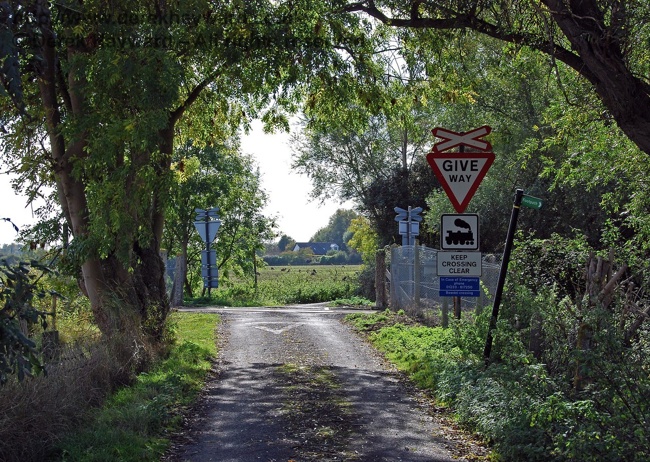 Bowdell Crossing looking west. A public footpath also crosses the line diagonally at this crossing and can be seen emerging from the trees on the right. 08.10.2008