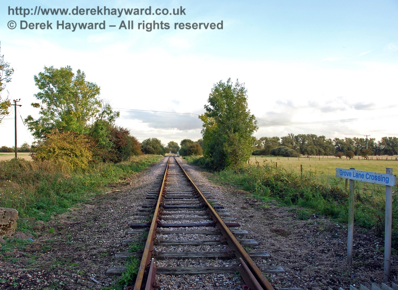 Looking south from Grove Lane Crossing, with Bowdell Crossing in the distance. When there were gates on this crossing the crossing keeper's cottage (since demolished) stood on the east side of the line, south of the road (to the left in this picture).  08.10.2008