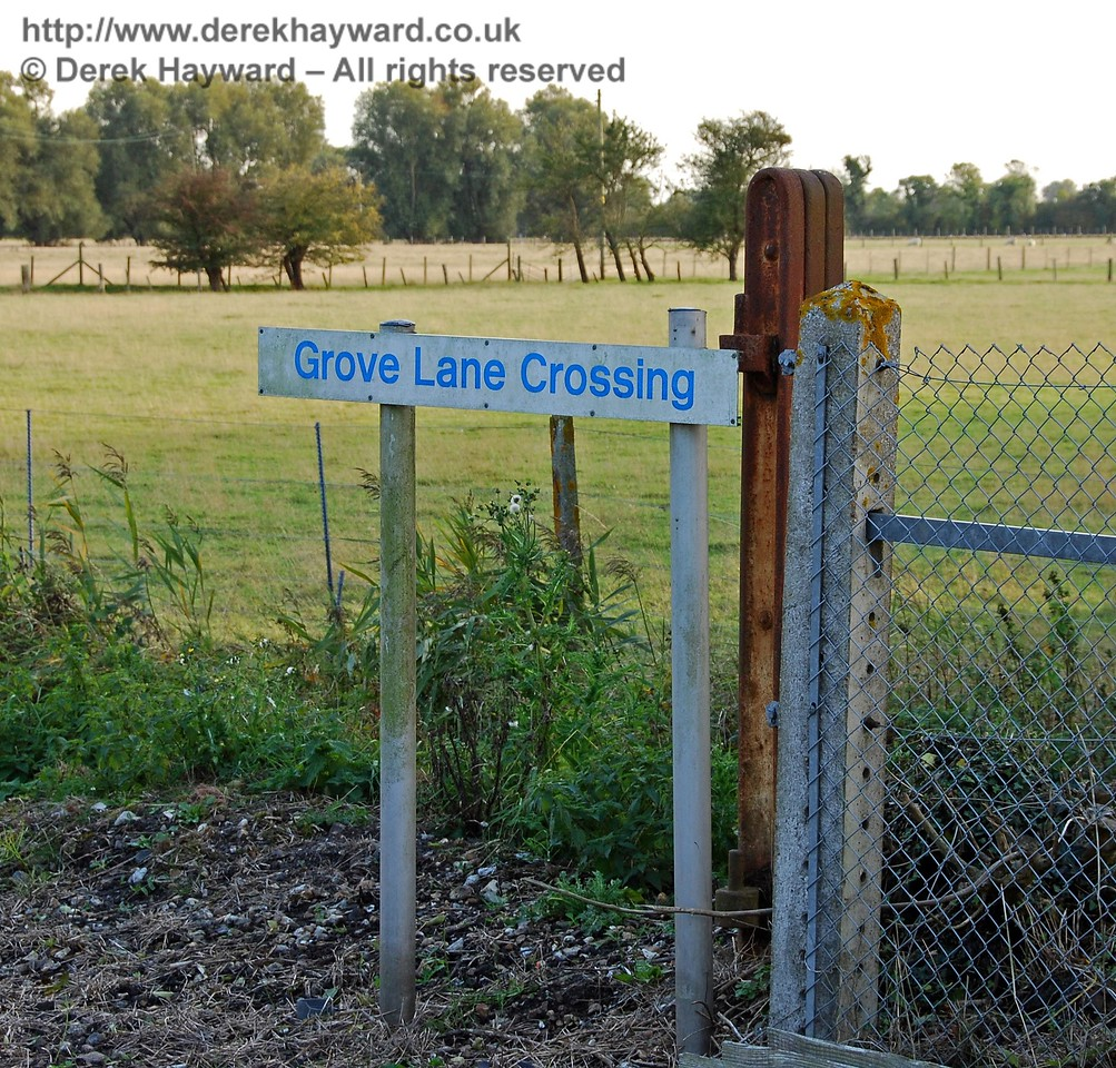 Grove Lane Crossing has a proper sign, although it could do with a clean.  The original level crossing gate post can be seen clearly, the only such relic found at the crossings.  This dates from the time when the branch was carrying passenger traffic. 08.10.2008