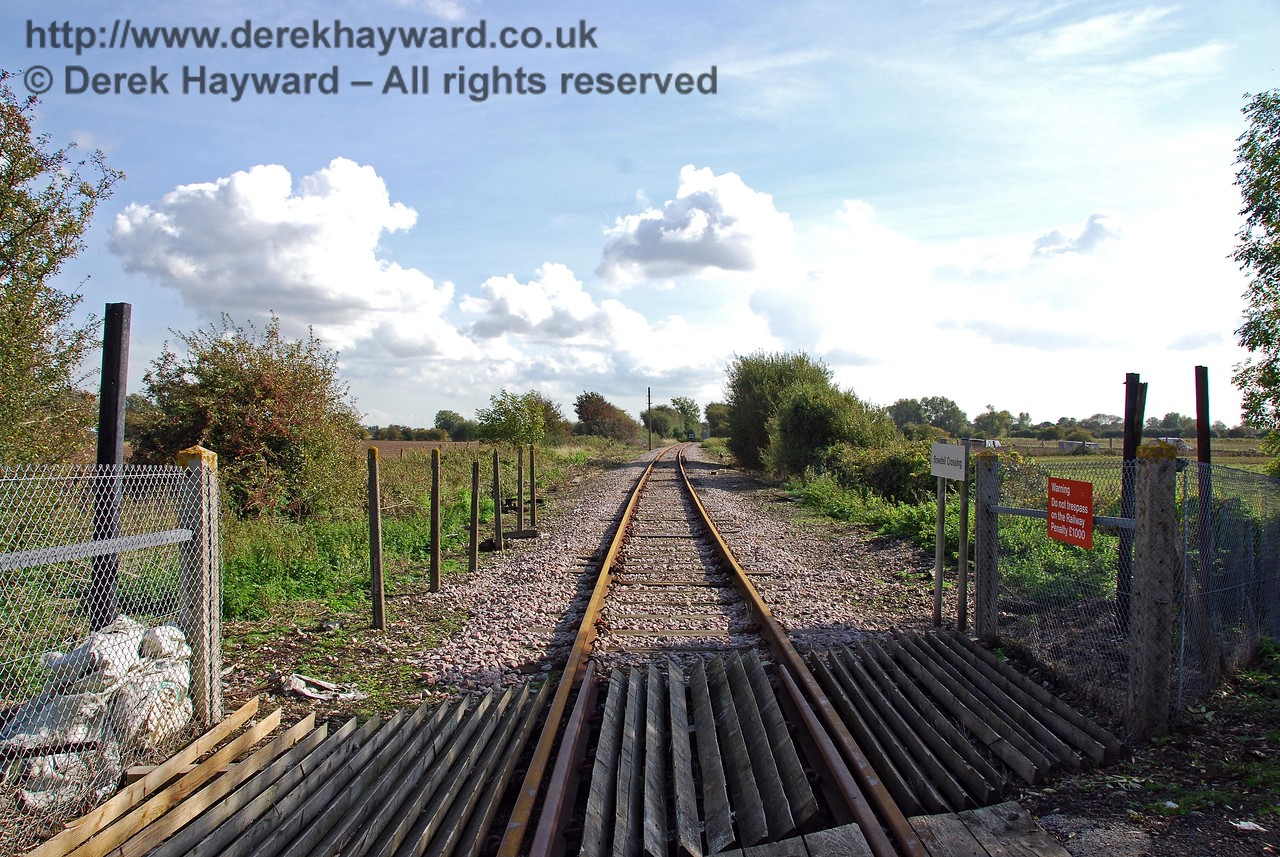 Looking south from Bowdell Crossing towards Dungeness.  When there were gates on this crossing the crossing keeper's cottage (since demolished) stood on the east side of the line, south of the road (to the left in this picture, behind the posts).  08.10.2008