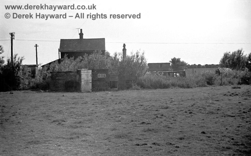 Mountain Crossing in 1969, looking toward the railway from the adjacent field.  Telegraph lines can be seen alongside the railway but the house had no power.  Copyright Neil Smith.
