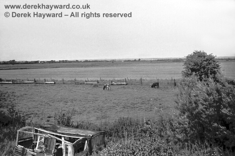 Mountain Crossing in 1969, looking out from the house across the surrounding flat landscape.  The remains of an old carriage, formerly used for accommodation, can be seen at the bottom of the shot.  Copyright Neil Smith.