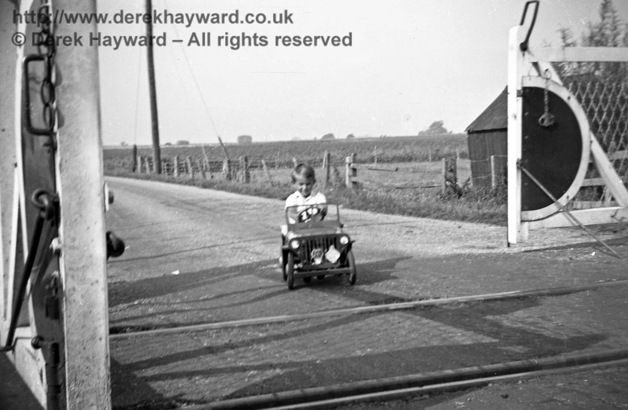 I am indebted to Malcolm Risk for supplying this image of his brother Terry using Swamp Crossing for the purpose for which it was intended in around 1949, even if the vehicular transport was slightly small.  Assuming the power poles have remained in the same position this view appears to look west.   Ownership of this image remains with the Risk family.