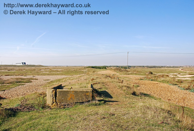 On the shingle mound which was Dungeness Station platform, and looking north, a small area of foundations marks the position of the small station building. 27.09.2008