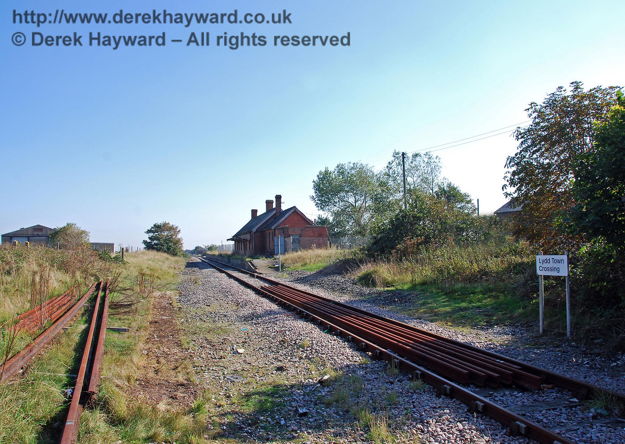 Looking south towards Lydd Town Station from the level crossing. When the station was functioning the land on the right of the track was occupied by an iron shed for the permanent way trolley, and by a water tower to supply the steam engines. 27.09.2008