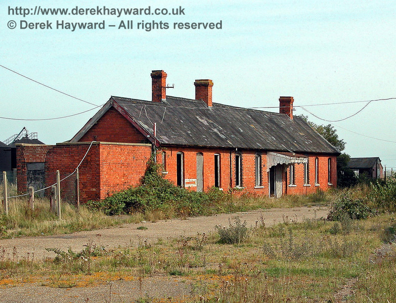 The entrance side of the Lydd Town Station building looking south on 02.09.2005. The old shed beyond the station had lasted well, as it appears in a historical picture of the station dating from 1958.