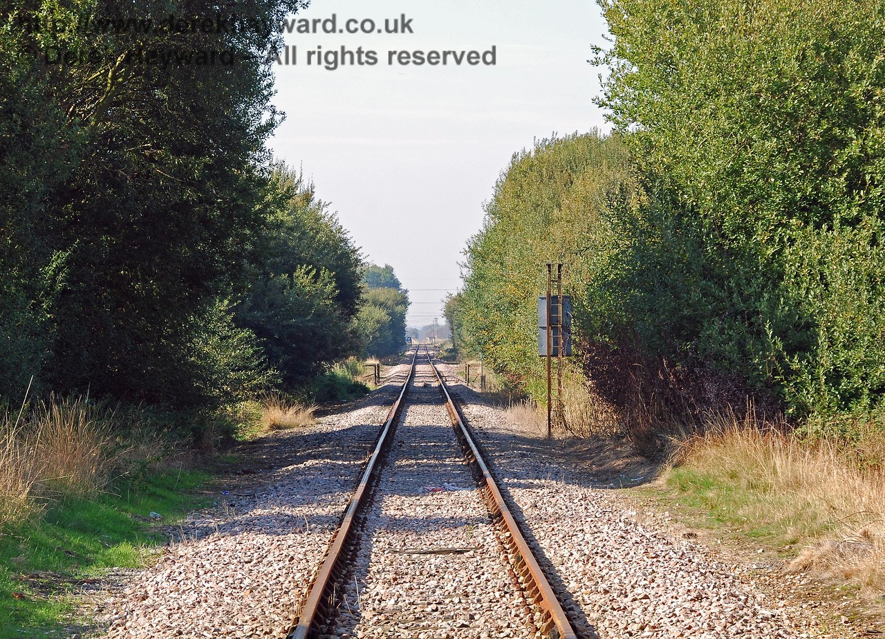 Still looking north from Lydd Town level crossing, but with a much longer lens, this shot looks through the bridge towards Brookland Halt and Appledore.   The railings at the centre of the photograph protect Culvert 1852, which carries Kitewell Petty Sewer.  27.09.2008