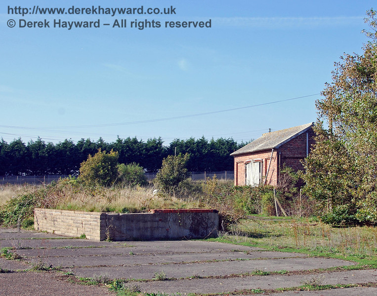 Moving the camera slightly to the right, but still looking north, this is the old cattle dock in Lydd Town goods yard, which was served by it's own siding.  The adjacent cattle pens have long gone. 27.09.2008