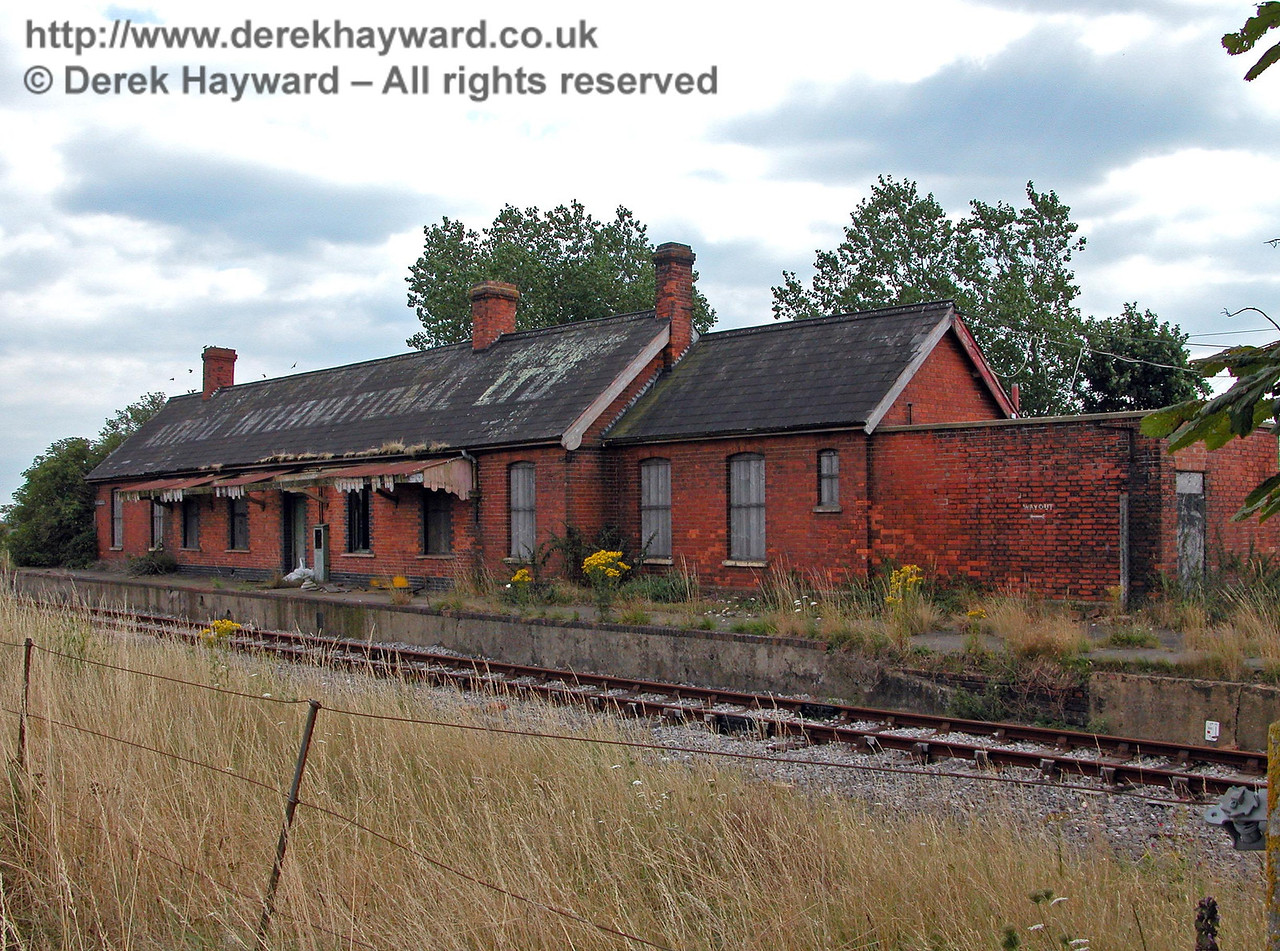Originally called Lydd Station, Lydd Town Station was renamed in 1937 when Lydd-on-Sea Station opened further to the east.  This view looking south dates from 08.08.2005 and shows the exterior structure largely intact, but in a sad condition.