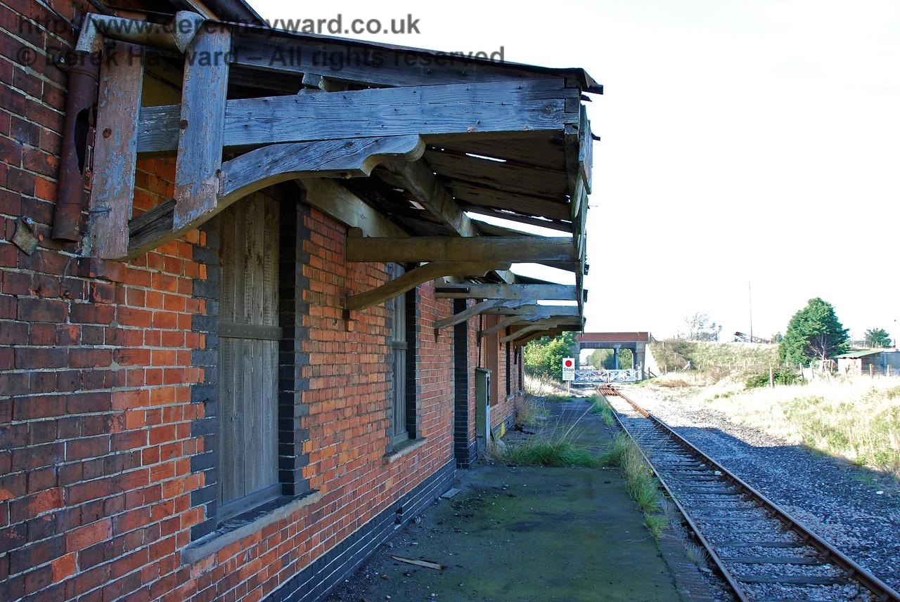 The remains of the canopy on the platform side of Lydd Town Station, in a very sad condition, although the supporting beams still appear very robust. They used good quality wood in the old days.... 27.09.2008
