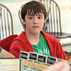 Dungeons & Dragons is becoming popular again and on Saturdays at the Stevens Memorial Library in Ashburnham you can play with Dungeon Master Zachary Sager. <br /> Alex Dekker listens to the DM as he tells them what trouble they are getting into. SENTINEL & ENTERPRISE/JOHN LOVE