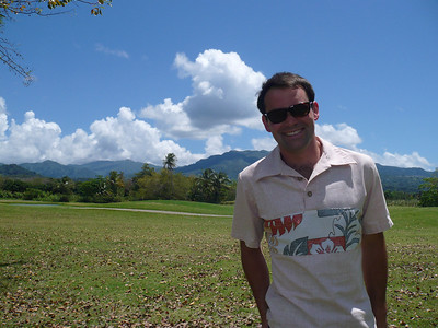 Tim in Puerto Rico with El Yunque rainforest in the distance