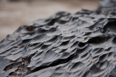 """Limestone sculpted by the pockmarking effects of """"cavitation erosion"""""""