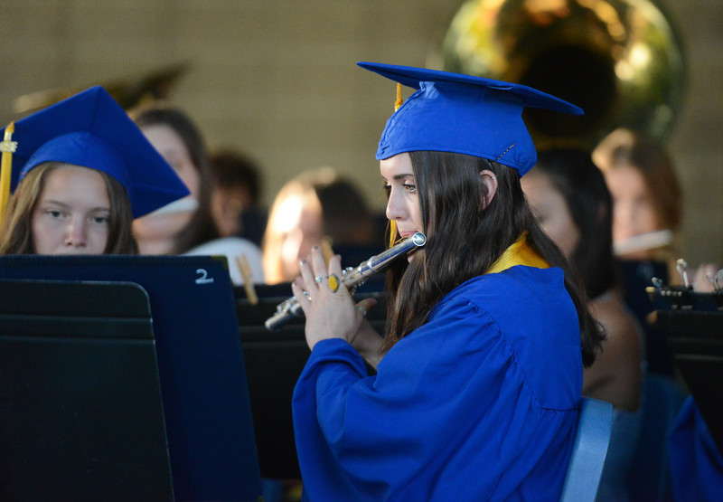 Alexis Tamayo-Romo plays the flute as the graduating band members play together one last time during the Durham High graduation ceremony,  May 31, 2018,  in Durham, California. (Carin Dorghalli -- Enterprise-Record)