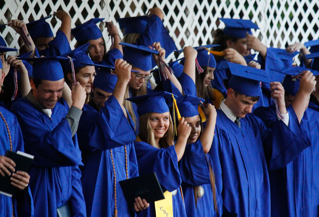 . The class of 2017 move their tassels to the left side of their caps after receiving their diplomas during the graduation ceremony Thursday June 1, 2017 at Durham High School in Durham, California. (Emily Bertolino -- Enterprise-Record)