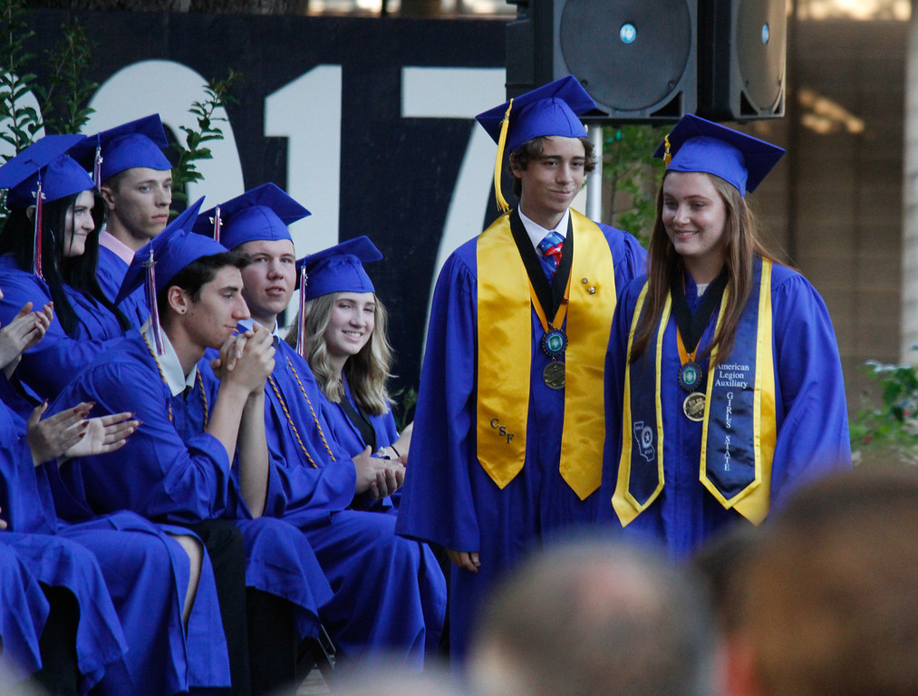 . Durham High School valedictorian Cody Arvonen and salutatorian Taylor Abouzeid take the stage to deliver their speeches to the graduating class of 2017 Thursday June 1, 2017 at Durham High School in Durham, California. (Emily Bertolino -- Enterprise-Record)