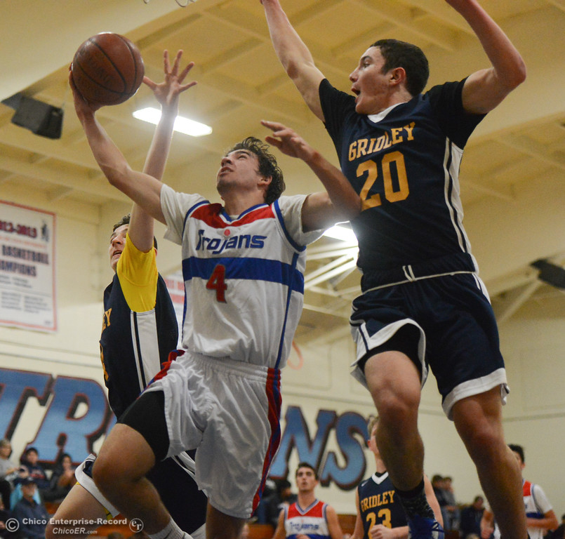 . Durham\'s Jordan Boorman goes up for a shot as Gridley Brian Wilkerson (20) and Grant Tull (4) tries to block during the first game of the annual Herb Jergentz tournament Thursday November 30, 2017 in Durham, California. (Emily Bertolino -- Enterprise-Record)