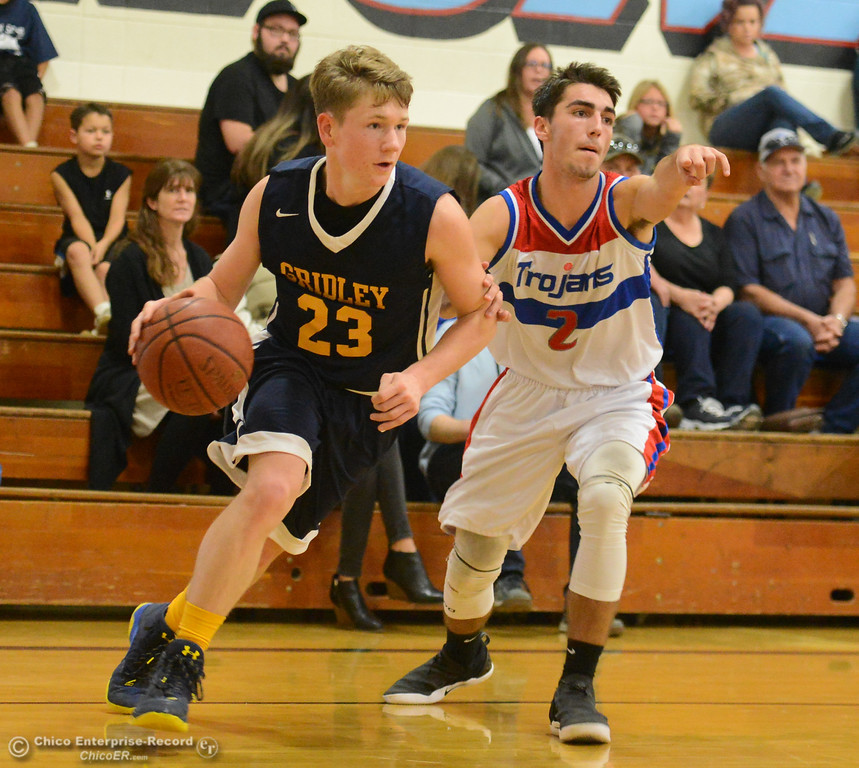 . Gridley\'s Randy Miller drives towards the basket as Durham\'s Colby Del Carlo plays defense in the first game of the annual Herb Jergentz tournament Thursday November 30, 2017 in Durham, California. (Emily Bertolino -- Enterprise-Record)