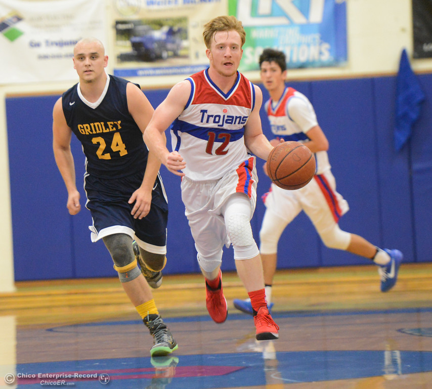 . Durham\'s Hunter Polk drives down court as Gridley\'s Tyler Little catches up in the first game of the annual Herb Jergentz tournament Thursday November 30, 2017 in Durham, California. (Emily Bertolino -- Enterprise-Record)