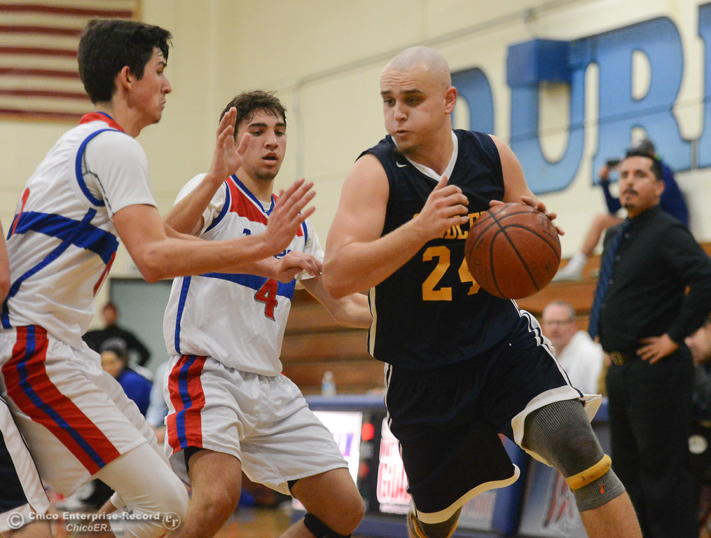 . Gridley\'s Tyler Little drives towards the basket as Durham\'s Jordan Boorman (4) and Colton Tillman (11) try to block in the first game of the annual Herb Jergentz tournament Thursday November 30, 2017 in Durham, California. (Emily Bertolino -- Enterprise-Record)