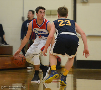 Durham's Colby Del Carlo dribbles down court as Gridley's Randy Miller blocks in the first game of the annual Herb Jergentz tournament Thursday November 30, 2017 in Durham, California. (Emily Bertolino -- Enterprise-Record)
