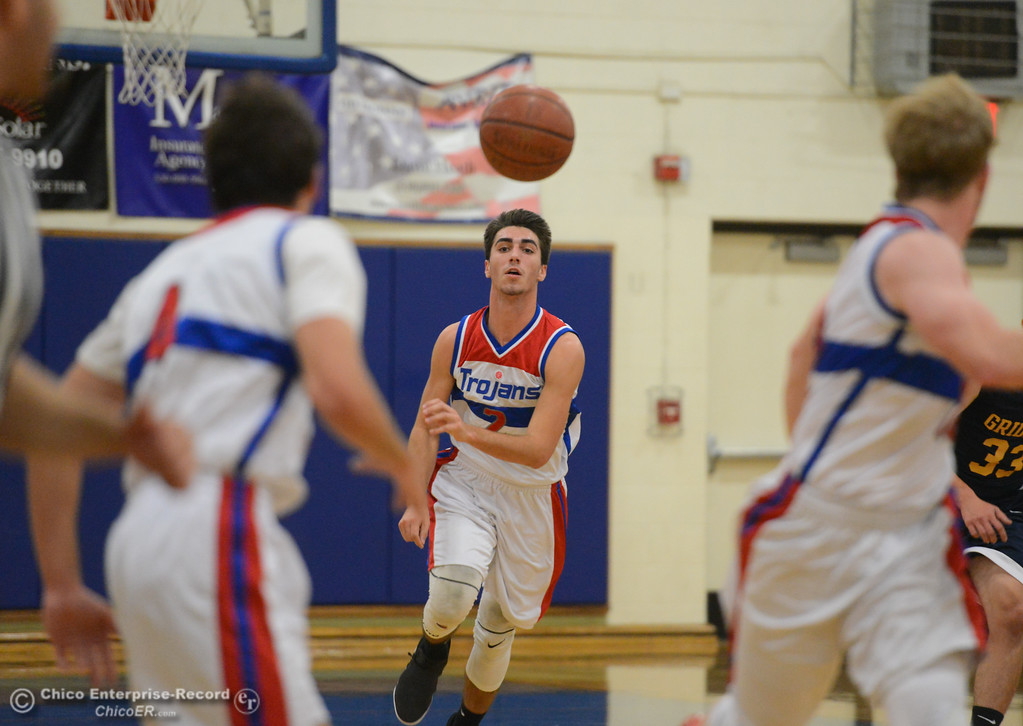 . Durham\'s Colby Del Carlo passes down court as the Trojans host the Gridley Bulldogs in the first game of the annual Herb Jergentz tournament Thursday November 30, 2017 in Durham, California. (Emily Bertolino -- Enterprise-Record)