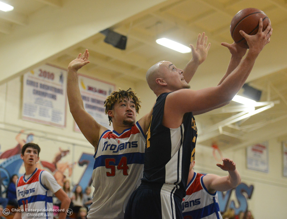. Gridley\'s Tyler Little goes up for a shot as Durham\'s Tyler Jones tries to block  in the first game of the annual Herb Jergentz tournament Thursday November 30, 2017 in Durham, California. (Emily Bertolino -- Enterprise-Record)