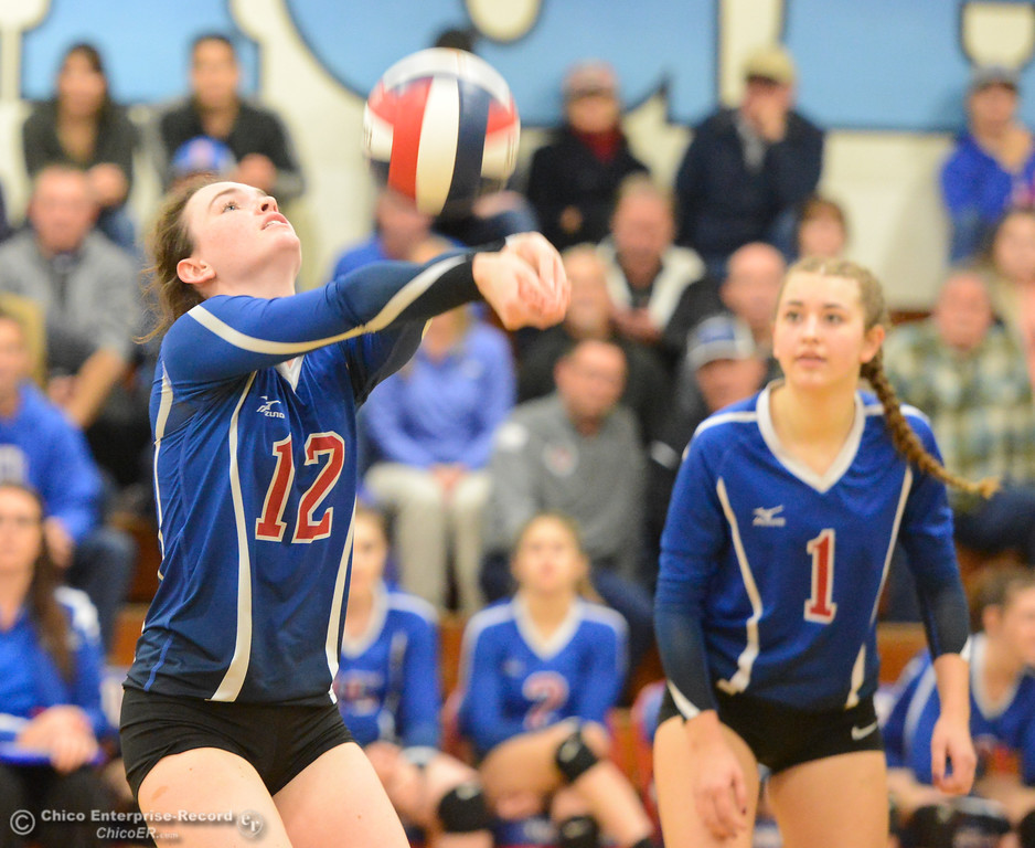 . Durham High\'s Emily McCabe (12) bumps the ball as teammate Nicole Luce (1) looks on as the Trojans host Bradshaw Christian in the first round of the state playoffs for Division V Wednesday November 15, 2017 in Durham, California. (Emily Bertolino -- Enterprise-Record