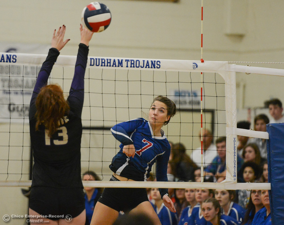 . Durham High\'s Ali Argo (7) spikes the ball past Bradshaw Christian\'s Sidney Ketterling in the first round of the state playoffs for Division V Wednesday November 15, 2017 in Durham, California. (Emily Bertolino -- Enterprise-Record