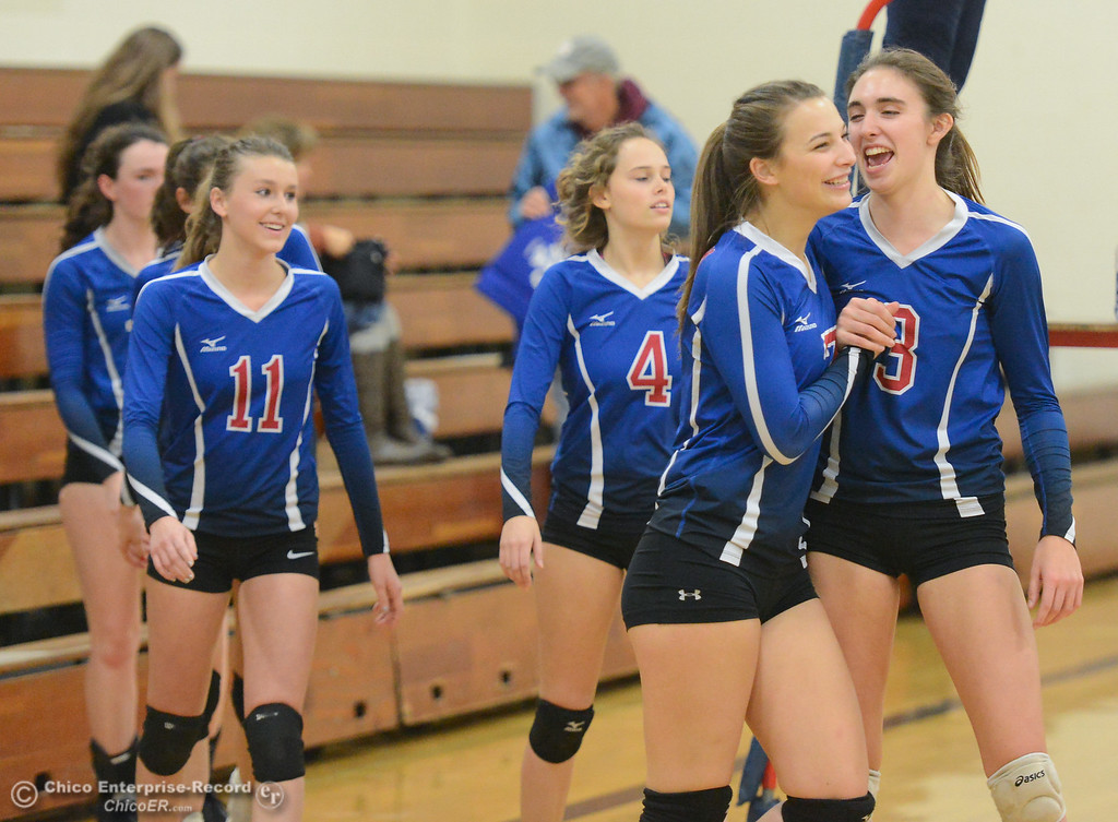 . Durham High\'s Ali Argo (7), Lindsey Bryant (3) and teammates celebrate after winning the second set against Bradshaw Christian in the first round of the state playoffs for Division V Wednesday November 15, 2017 in Durham, California. (Emily Bertolino -- Enterprise-Record